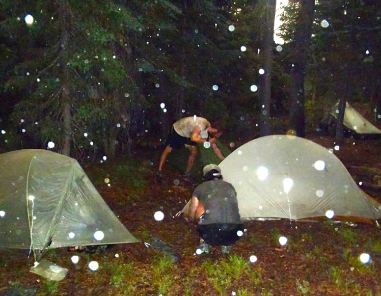 Setting up our wet tents during a downpour in Oregon last summer